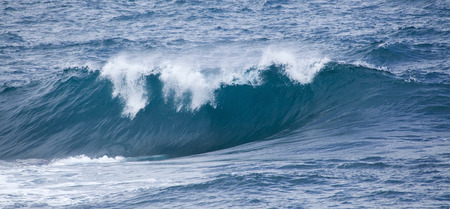shores: powerful foamy ocean waves breaking by the shores of Gran Canaria