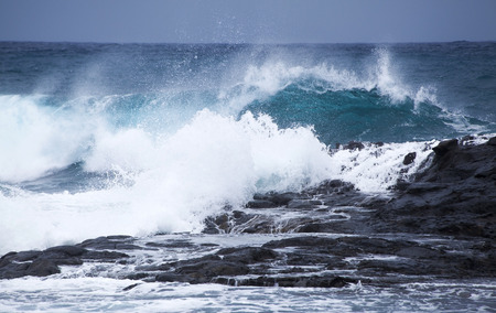 unstoppable: powerful foamy ocean waves breaking by the shores of Gran Canaria