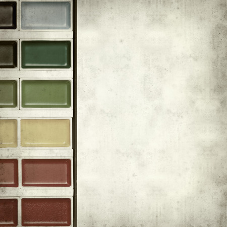 paintbox: textured old paper background with watercolor paint set