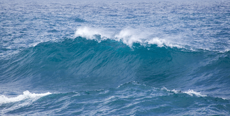 kinetic energy: powerful foamy ocean waves breaking by the shores of Gran Canaria