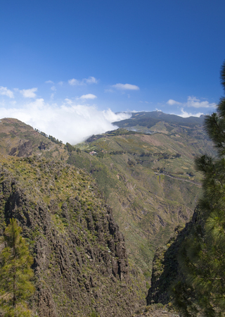 accumulate: Gran Canaria, Caldera de Tejeda in May, clouds accumulate at mountain pass Cruz de Tejeda