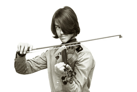 grandad: portrait of teen with long surfer haircut playing violin isolated on white Stock Photo