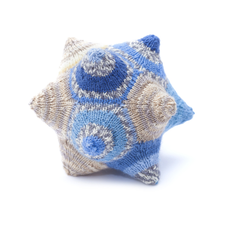remains: knitted stellated dodecahedron, yarn remains project