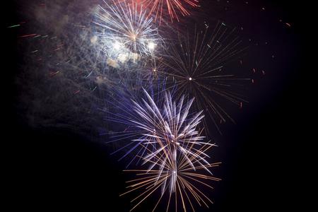 simultaneous: exploding fireworks on black background