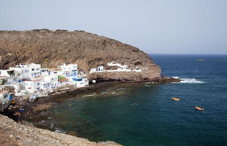 Gran Canaria, Cove Playa de Tufia and small Tufia village, including some cave houses Stock Photo