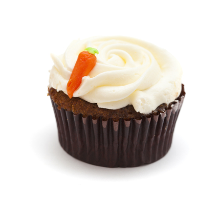 sinful: carrot cupcake with butter and sugar icing isolated on white Stock Photo