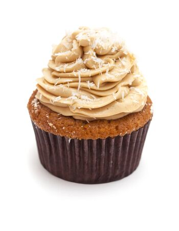 sinful: toffee and coconut cupcake isolated on white background Stock Photo