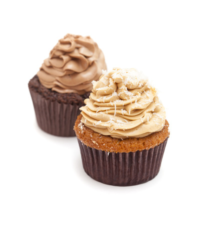 guilty pleasures: toffee and coconut and chocolate cupcakes isolated on white background