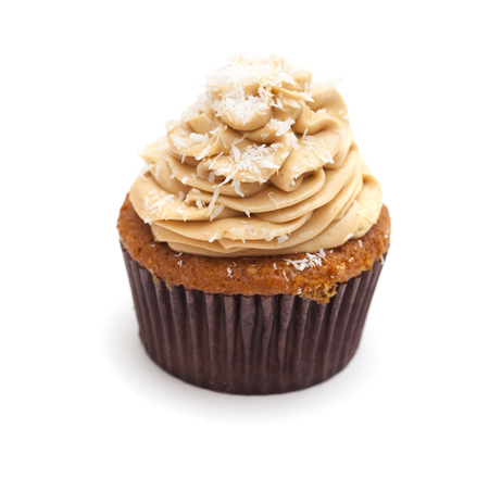 guilty pleasures: toffee and coconut cupcake isolated on white background Stock Photo