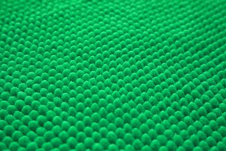 man made: surface of brand-new soft bathroom mat man made regular texture background