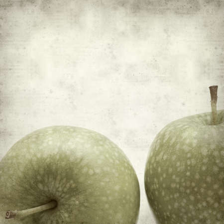 keeps: textured old paper background with fresh green apples