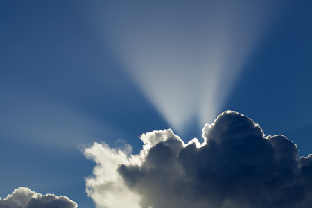 skyscapes: sun behind cumulus clouds natural skyscape background