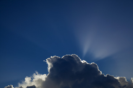 skyscape: sun behind cumulus clouds natural skyscape background