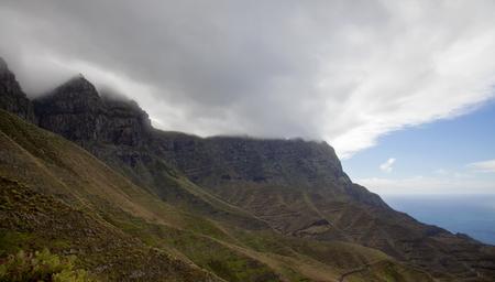 pinar: Gran Canaria, steep cliffs of north west coast, dangerous road to La Aldea de San Nicolas visible Stock Photo