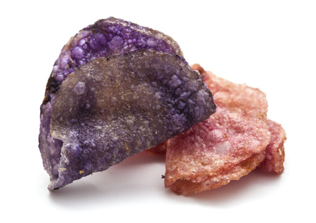 fancy potato crisps made of naturally pink and purple potatoes isolated