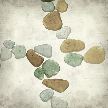 textured old paper background with sea glass pieces Stock Photo