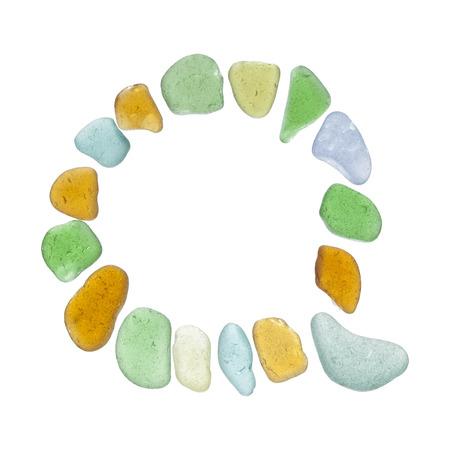 backlit sea glass pieces mosaic, drop cap letters Stock Photo