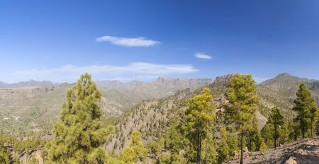 Central Gran Canaria, natural park Pilancones in  San Bartolome de Tirajana municipality, panoramic view towards Roque Nublo and summits of the island