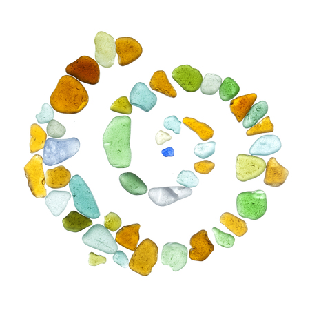 chemically: backlit sea glass peices isolated  on white background