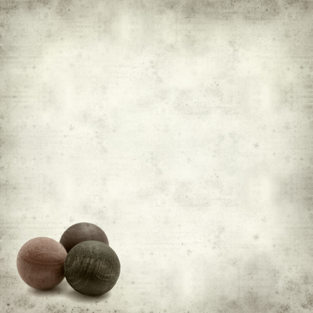perfumed: textured old paper background with wooden balls air fresheners Stock Photo