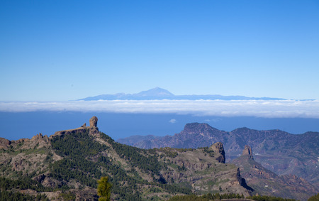 central Gran Canaria in January, view from the highest point of the island, Pico de Las Nieves, across Caldera de Tejeda towards Teide on Tenerife. Both Roque Nublo and Roque Bentayga visible