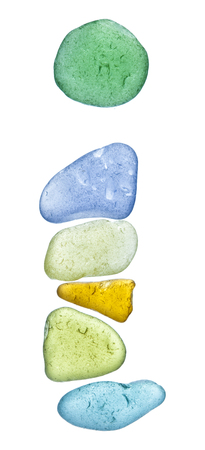 finding out: backlit sea glass pieces mosaic, drop cap letters Stock Photo