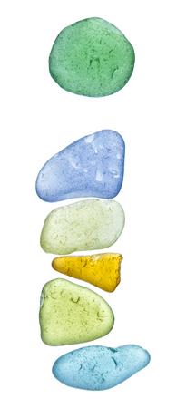 backlit sea glass pieces mosaic, drop cap letters Reklamní fotografie