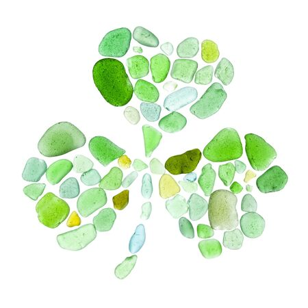 finding out: shamrock leaf made of seaglass on white background Stock Photo