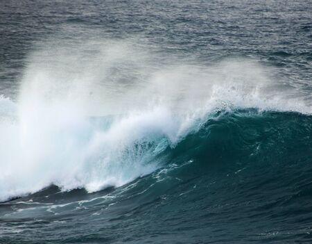 powerful ocean wave breaking, clean renewable energy background