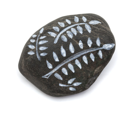 artictic: pebble painting - lava pebble with floral design on white background