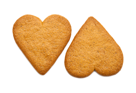 traditional heart shaped thin ginger biscuits isolated on white background
