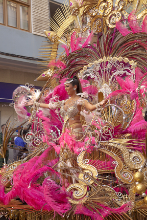 Las Palmas de Gran Canaria, Spain - March 04: Carnival Dame greets the public at Main Carnival Parade, March 4, 2017  in Las Palmas de Gran Canaria, Spain
