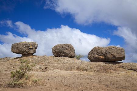 unofficial: Inland Gran Canaria, April, Las Tres Piedras, three eroded rocks on the top of small mountain range, symbol of Santa Brigida municipality Stock Photo