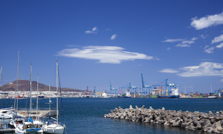 wind-smoothed clouds over Las Palmas de Gran Canaria Port area