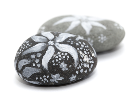 artictic: lava pebble painted with white paint isolated