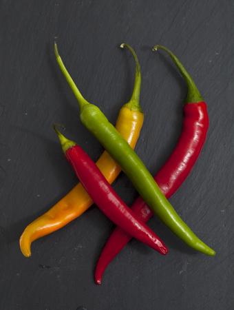 hot chili pepper on black slate surface