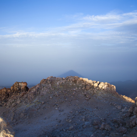 acute: Canary Islands, Tenerife, from the top of Teide, the tallest mountain in Spain; time soon after sunrise, triangular shadow of Teide  on the mist  below