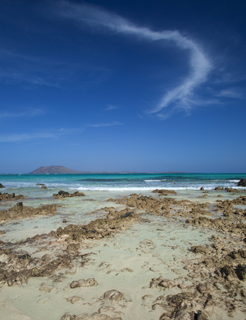 Fuerteventura, Canary Islands, Flag beach in the northern part of the island close to Corralejo village, small islands Isla de Lobos in the background