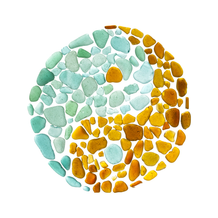 yin yang sign made of seaglass on white background