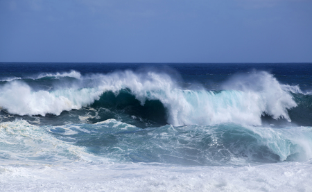 Gran Canaria, foamy waves breaking by the shore in Banaderos area