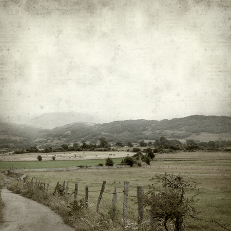textured old paper background with rural landscapes of Cantabria, North of Spain