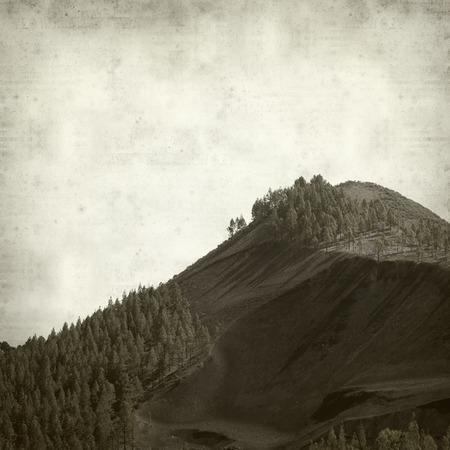 textured old paper background with Gran Canaria landscape, Galdar municipality, black volcanic ash  Montanon Negro, Black Montain Reklamní fotografie
