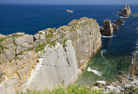 Cantabria, coastal landscape along Costa Quebrada, The Broken Coast, group of small islets called Urros de Liencres 写真素材 - 106891538
