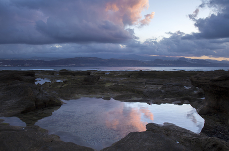 Gran Canaria, sunset at El Confital beach at the edge of Las Palmas, the capital of the island Stock Photo