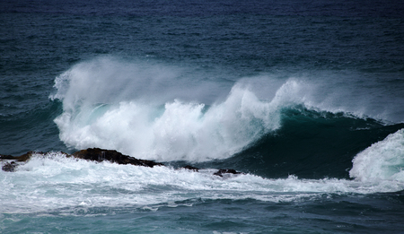 powerful ocean waves breaking by the shores of Gran Canaria