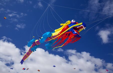 FUERTEVENTURA, SPAIN - NOVEMBER 10: Visitors enjoy beautiful display of flying kites of  at 31th International Kite Festival, November 10, 2018 in Nature park Dunes of Corralejo, Fuerteventura, Spain