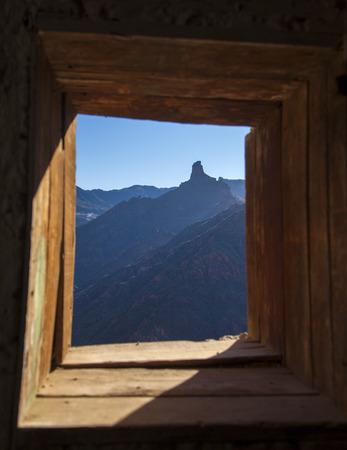 Gran Canaria, December, Las Cumbres,  Roque Bentayga as seen from a cave house in Acusa Seca