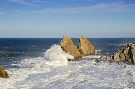 Coast of Cantabria,  landscape along Costa Quebrada, The Broken Coast, access to rock formation at Playa de la Arnia covered by high tide 写真素材