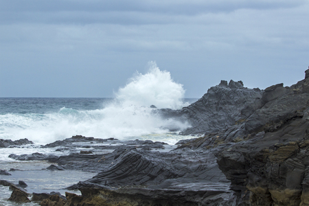 natural background of foamy ocean waves breaking by the shores of Gran Canaria Banco de Imagens