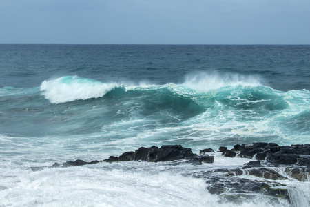natural background of foamy ocean waves breaking by the shores of Gran Canaria 스톡 콘텐츠